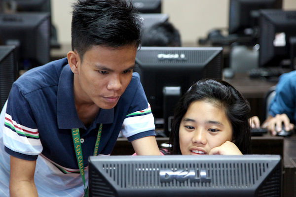 PNP staff helping a student during practice.