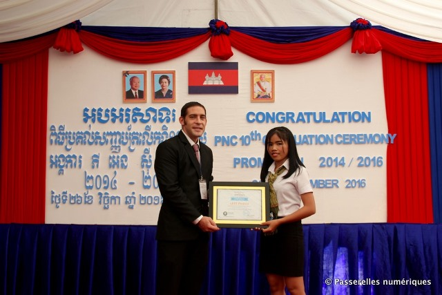 Ponleu, on her graduation day with John Munger, General Manager at PNCambodia